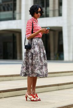 Our social media coordinator in a top, skirt, and shoes from #crossroadstrading at #nyfw #mbfw. Photo by www.streetpeeper.com