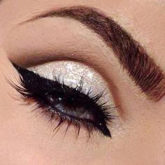 dark eyeliner and mascara, light sparkly on lid, darker brown in crease, fading up slightly.