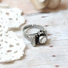 pewter camera ring...with rhinestone lens.