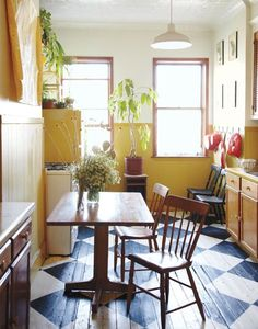 yellow and white kitchen, chequered painted floor