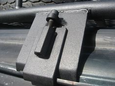 Roof rack gutter mounting system