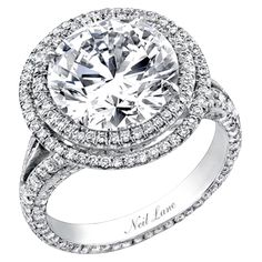 Neil Lane double tiered halo split shank round diamond engagement ring. So Hollywood glam!