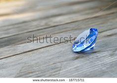 Blue Gemstone on wood. - stock photo