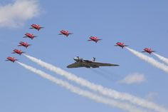 With the end of flying displays by the Avro Vulcan towards the end of this year, the Cold War bomber flew with the Royal Air Force Aerobatic team, the Red Arrows during the show to mark its final display season. Photo Gallery: 2015 Royal International Air Tattoo Highlights | Aviation Week