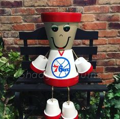 Excited to share this item from my shop: Philadelphia Flower Pot People / basketball decor/ clay pot people/ Flower Pot People, Clay Pot People, New England Patriots, Painted Clay Pots, Hand Painted, Pots D'argile, Basketball Decorations, Handmade Christmas Decorations, Flower Pots