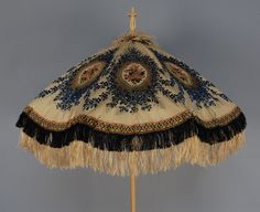 SILK BROCADE PARASOL with CARVED IVORY HANDLE, 1850's