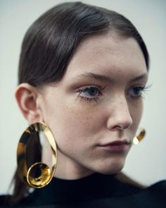 awaykeeping: Giant, sculptural earrings today at #mfw @marni.official. Photo by @sarahaubel. by tmagazine http://ift.tt/1R9GOJs