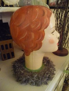 HAT STAND... via Etsy.  great texture on the hair...