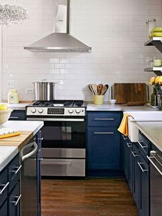 Hardwood floors give this kitchen a rugged quality that is quite the opposite of the modern appliances and accessories that make up the rest of the room: http://www.bhg.com/kitchen/color-schemes/inspiration/kitchen-color-scheme/?socsrc=bhgpin040614navyandsnowwhite&page=3