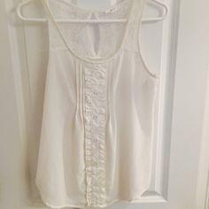 Cream Blouse with Ruffle Design Worn only a couple times. Off-white, cute design! Ruffle design, lace and buttons. No trades Tops Tank Tops