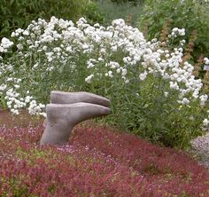 concrete boots in the garden - ha ha! For the gardeners with a warped sense of humor ;)~