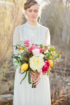 Bridal bouquet with a lemon detail   (Parentheses) Photography   see more on: http://burnettsboards.com/2014/06/15-wedding-dress/ #bridalbouquet