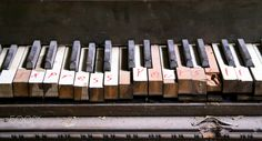 Express Yourself - Express Yourself is written in red pen on the keys of this abandoned piano.