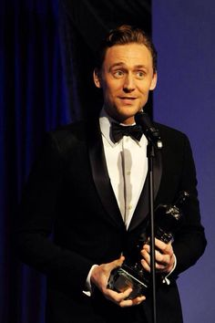 Tom Hiddleston accepts the Best Actor award for 'Coriolanus' at the 60th London Evening Standard Theatre Awards at the London Palladium on November 30, 2014.