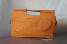 Orange open handle vintage bag from the 70's wooden handle purse.