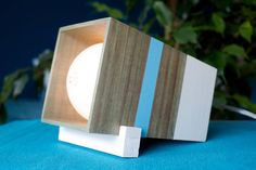 Handmade wooden prism design table lamp with dimmer  ∞∞∞ FREE SHIPPING to Europe ∞∞∞  Limited Edition, 1 copie  Green, blue and white prism box Size - 17 x 10 x (9x9)cm E27 socket an dimmer Ecolite 70W Bulb is included, but also we highly suggest dimmable LED and You can deem light of bulb from barely noticeable to reeding light.  Transparent 2meters cable with EU 2 pin plug Security: this lamp includes a dimmer and is not compatible with the eco (with tube) bulbs or LEDs (except dimmable…