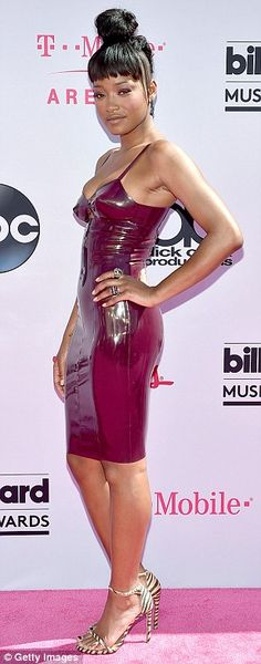 Lovely in latex: Keke Palmer showed off her fabulous figure in an oh-so-tight pencil dress...