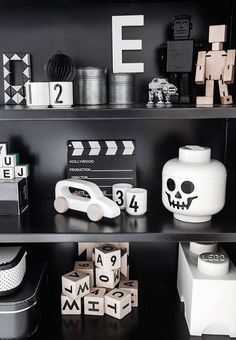 monochrome b&w. Want to style some shelves in black and white. Love the repainted Lego storage head.