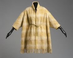 Woman's Coat  Designed by Bonnie Cashin, American, 1915 - 2000. Made by Sills and Co., American, 1946 - 1977. Worn by Leola Marva, American.