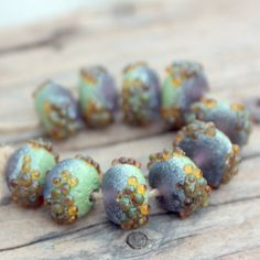 Beach+Rocks+in+Green+and+Purple+10+lampwork+beads+by+Meital,+$25.00