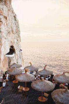 Clifftop tables at Cova d'en Xoroi, Menorca. Photo: Mirjam Bleeker #BalearicIslands
