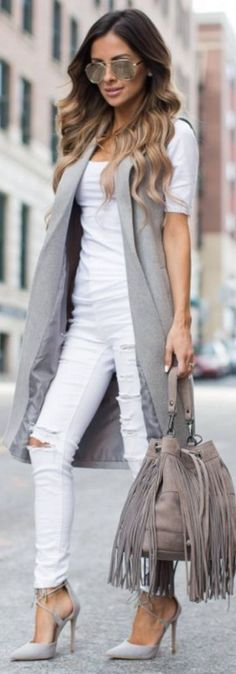 I've worn this gray vest several times on the blog already, but I just can't get enough of it. It's so versatile and can be easily worn for work or dressed down for a more casual day. It's no secret that I love neutrals lately so I kept an all white palette and added gray accents. I brought this gray fringe bucket bag with me on our trip because it's easy to carry as a crossbody and the neutral color easily pairs with most outfits   Fringe bag  Mia Mia Mine #ive