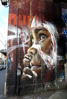 Street art by Adnate in Gertrude St. Fitzroy. Melbourne, Australia (Gertrude St. has had a long connection to the Aboriginal community; it's now a highly gentrified inner-city suburb)