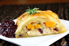 Delicious recipe using leftover turkey for Turkey, Cranberry and Butternut Squash tucked inside Puff Pastry. Photograph included.