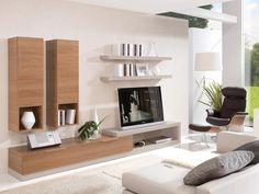 Walnut wall storage and display system with TV stand