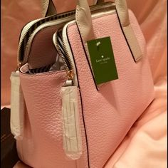 NWT Kate Spade Southport Avenue Lydia NWT just in- gorgeous pale pink and off white purse with black and white striped interior. Comes with dust bag. This classic bag will compliment any spring outfit. kate spade Bags Satchels