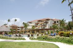 Guests relax by the pool at Now Larimar in Punta Cana where they experience unlimited luxury.