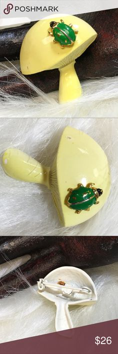"""Vintage 70's Mushroom & Ladybug Brooch This is so cute! A darling little gold tone ladybug colored in green sitting atop a yellowish mushroom. Very 70's.   Measurements: 1.25"""" X 1.25""""  Condition: color loss on the mushroom and ladybug, please see photos. Vintage Jewelry Brooches"""