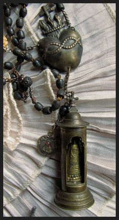 Our Lady of Halle, Miraculous Madonna, WW I Bullet Pocket Shrine Necklace. $210.00, via Etsy.