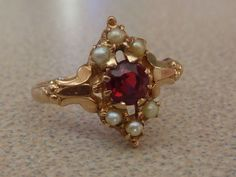 Victorian ring Rose gold seed pearls and tourmaline Garnet or ruby Simple Jewelry, Jewelry Ideas, Unconventional Engagement Rings, Victorian Ring, Old Rings, Heart Shaped Rings, Pearl Gemstone, Antique Roses, Antique Jewellery