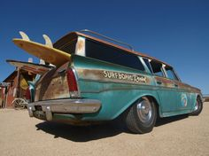 1961 Rambler Rat Rod at the beach with surfboards