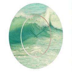 Lisa Argyropoulos Sonata Oval Clock | DENY Designs Home Accessories