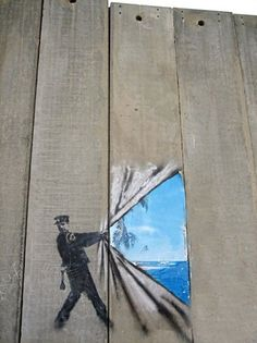 Rolling back the wall by Banksy