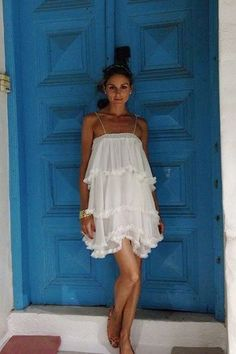 """Olivia Palermo: """"Regardless of where I'm heading, there are some clothes that come with me on every summer holiday, every year – like my favourite white ruffled dress by D It's perfect for day or night, and it's super comfortable. I never want to wear anything restrictive on holiday – it's vacation!"""""""
