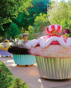 I want a cupcake car!!! I'd drive it everywhere!! It's even electric so I wouldn't have to pollute the world except with smiles and joy!! Alas it's $25,000 so someone will have to gift it to me.