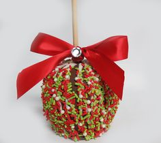 Christmas Sprinkles Sassy Apple Orchard fresh apple hand dipped in rich creamy caramel, coated with milk chocolate and topped with Christmas Sprinkles. $12.95