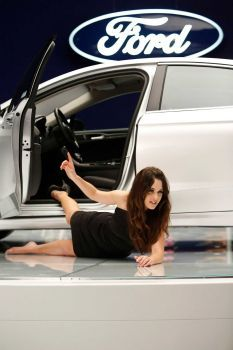 """Jess (Zooey Deschanel) falls out of a car while on the job at a car show on """"New Girl."""""""