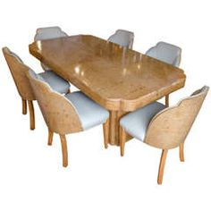For Sale On   An Art Deco Cloud Dining Suite By Harry And Lou Epstein.  Figured Walnut Table Set On Two Pedestal Legs And Six Leather Upholstered,  ...