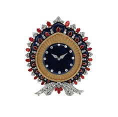 Table clock, 1968 - Gold and platinum with lapis lazuli, rubies and diamonds.  Courtesy of de Young Museum