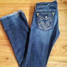 Mek denim size 25 Bootcut distressed denim. 34inch inseam tattered bottoms and front rip....intentional design MEK Jeans