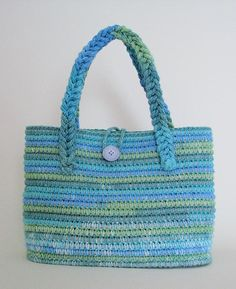 Thread and Wood - Crocheted bag - Cotton yarn over clothesline. Handle from cotton yarn braided with lucet tool.  See more at ThreadAndWood.com