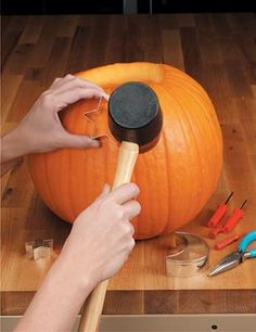An easier, safer way to carve pumpkins with kids - use cookie cutters and a mallet. #pumpkin #halloween #thanksgiving #fall #holiday #decorate #carve #carving
