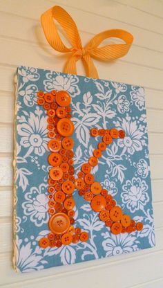 "Custom Button Letter Wall Art -- Orange Monogram on Turquoise -- 8""x10"" -- by Letter Perfect Designs on Etsy. $55.00, via Etsy."