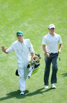 Rory McIlroy of Northern Ireland walks alongside his caddie Niall Horan of the band One Direction. The two are friends.