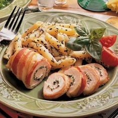 Bacon-Wrapped Chicken Recipe from Taste of Home -- Tender chicken gets a special treatment when spread with a creamy filling and wrapped with tasty bacon strips. -- MarlaKaye Skinner of Tucson, Arizona.