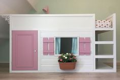 This is a hack of the IKEA KURA into a playhouse bunk bed. It offers a neat space beneath the bed for play, with the ladder converted for additional storage shelves. IKEA items used: IKEA Kura bunk b